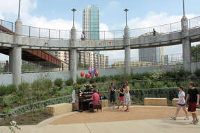 A piano on the pedestrian bridge over Lady Bird Lake inspires impromptu concerts. KATHLEEN SCOTT / SPECIAL TO THE EXPRESS-NEWS