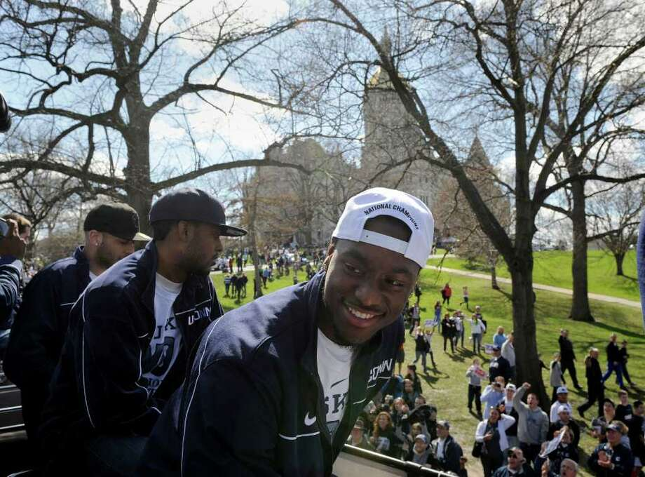 Kemba Walker, a member of Connecticut's national champion 2011 men's basketball team, celebrates during a victory parade in Hartford, Conn., on Sunday, April 17, 2011. (AP Photo/Fred Beckham) Photo: Fred Beckham, AP / FR153656 AP