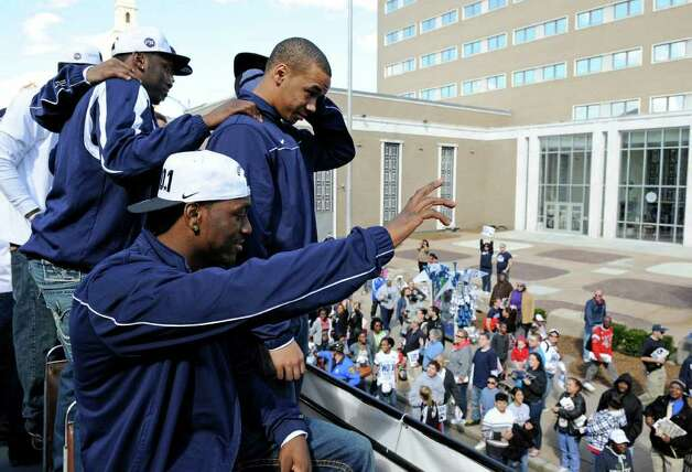 Members of Connecticut's 2011 national champion men's basketball team celebrate aboard a double-decker bus during a victory parade in Hartford, Conn., on Sunday, April 17, 2011. (AP Photo/Fred Beckham) Photo: Fred Beckham, AP / FR153656 AP