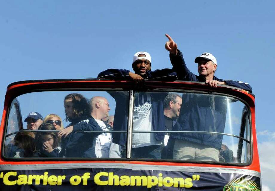 Kemba Walker, left, and head coach Jim Calhoun of Connecticut's 2011 national champion basketball team celebrate aboard a double-decker bus during a victory parade in Hartford, Conn., on Sunday, April 17, 2011. (AP Photo/Fred Beckham) Photo: Fred Beckham, AP / FR153656 AP