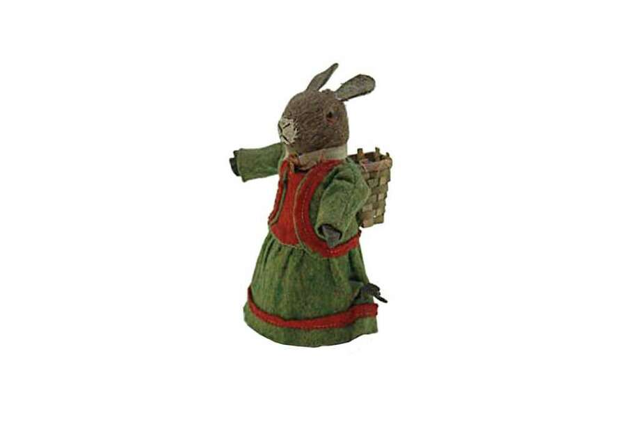 "This 6-inch-tall rabbit can ""walk"" across the floor. The fur-covered clockwork toy has glass eyes, wears a felt dress and carries a wicker basket. It was made in Germany probably about 1900 and sold for $633 at a Bertoia auction in Vineland, N.J. Photo: Contributed Photo / The News-Times Contributed"