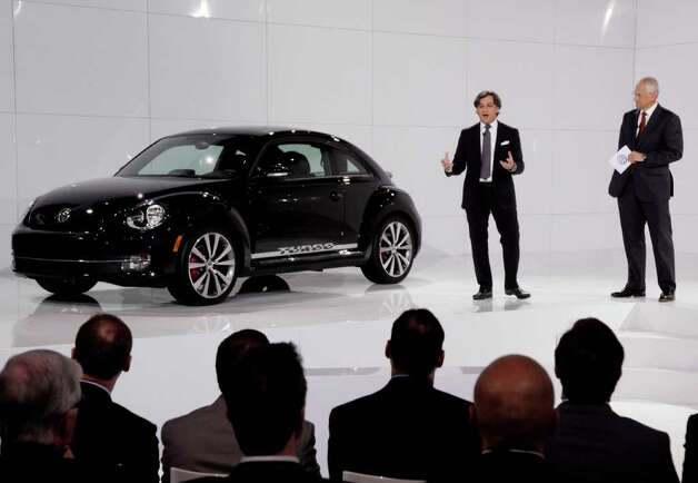 Luca de Meo, left, head of global marketing, Volkswagen Group, and Jonathan Browning, president and CEO, Volkswagen Group of America, introduce the 2012 Volkswagen Beetle, in New York,  Monday, April 18, 2011. Photo: Richard Drew, AP / AP