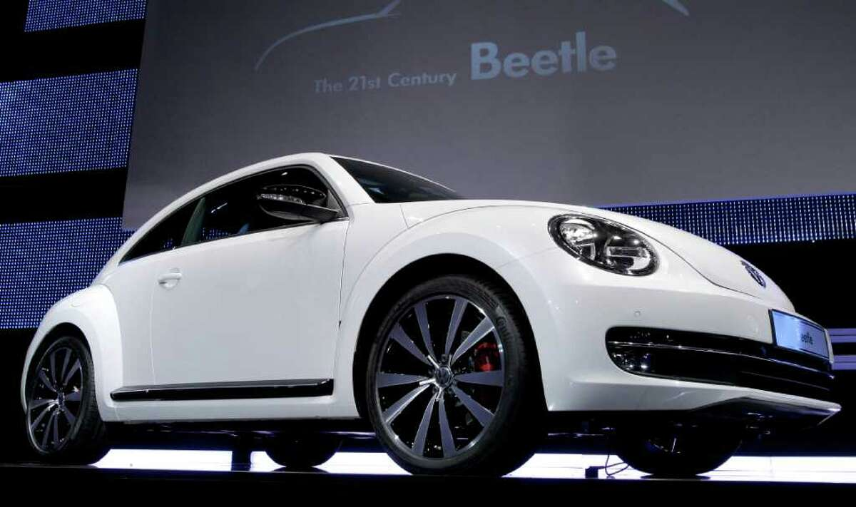 The new Beetle car by the German car company Volkswagen is presented during a news conference in Berlin Monday, April 18, 2011. In its 73-year history, the Beetle has evolved from the hippie ride of choice to a cute chick car. Now Volkswagen is reinventing it again.