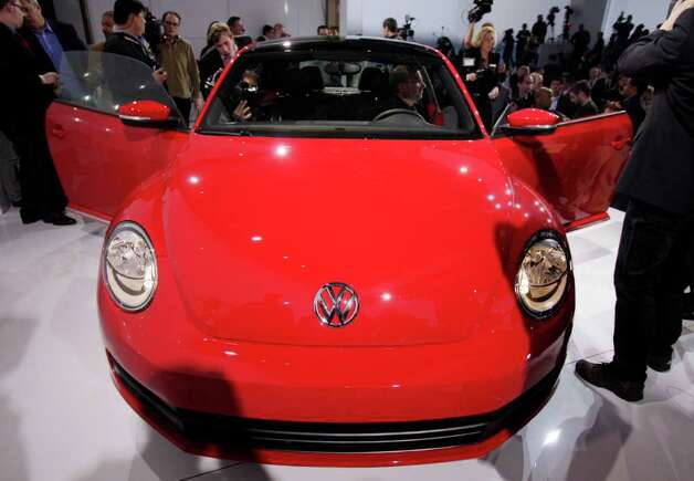 The 2012 Volkswagen Beetle is introduced, in New York, Monday, April 18, 2011. In its 73-year history, the Beetle has evolved from the hippie ride of choice to a cute chick car. Now Volkswagen is reinventing it again. Photo: Richard Drew, AP / AP