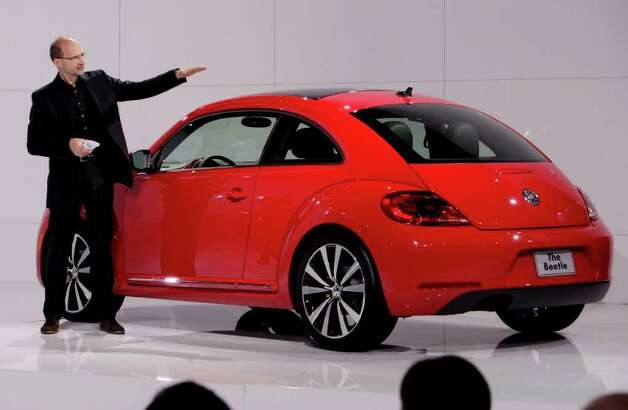Klaus Bischoff, head of design for Volkswagen Brand, introduces the 2012 Volkswagen Beetle, in New York, Monday, April 18, 2011. Photo: Richard Drew, AP / AP