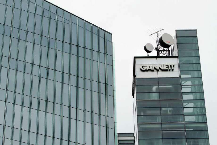 FILE - In this file photo take July 14, 2010, Gannett headquarters in McLean, Va., is shown.  Gannett the publisher of USA Today and more than 80 other daily newspapers, says its first-quarter net income fell, weighed by special charges, higher newsprint expenses and soft ad demand in the U.K. (AP Photo/Jacquelyn Martin, file) Photo: Jacquelyn Martin
