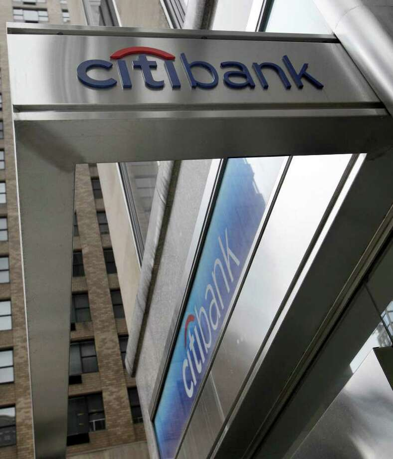 FILE - In this April 13, 2010 file photo, a branch of Citibank in New York, is shown. Citigroup Inc. reported Monday, April 18, 2011, first quarter 2011 net income of $3.0 billion, or $0.10 per diluted share. Net income declined $1.4 billion from the first quarter 2010, but more than doubled sequentially. (AP Photo/Richard Drew, file) Photo: Richard Drew