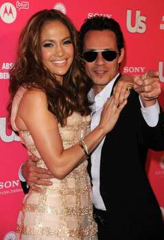Marc Antony, seen here with wife Jennifer Lopez, is among Rolling Stone's list of top 10 tax-challenged musicians. Photo: Jason Merritt, Getty Images / 2010 Getty Images