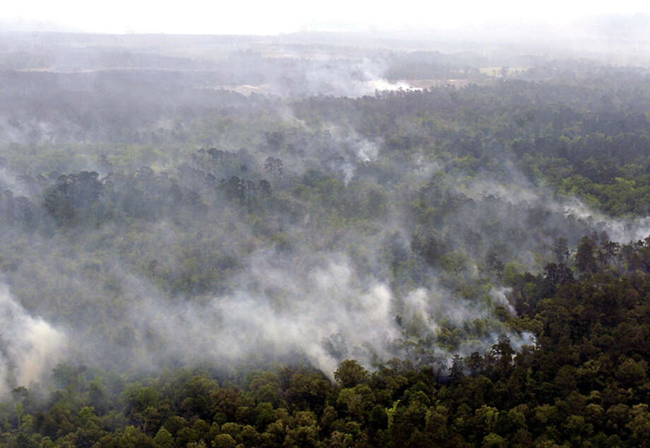 This is an aerial view of some  of the wildfires that have burned about 7,500 acres of Hardin County  forest land since Saturday.  The fires are reported to be approximately  75 percent contained with firebreaks in place.  Volunteer firefighters  and contractors are working alongside the Texas Forest Service and the  U.S. Fish and Wildlife Service to get the fires under control. Dave  Ryan/The Enterprise