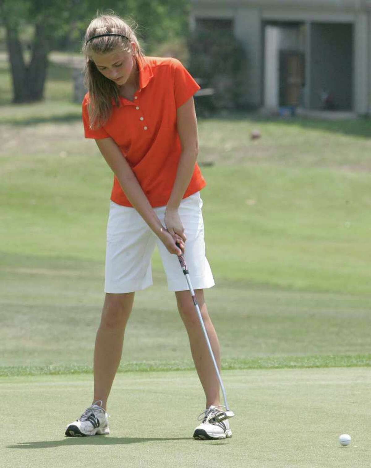 Medina Valley's Caitlyn Keller putts on the ninth hole Monday, April 18, 2011, in the first round of the Region IV-4A girls' golf tournament at Pecan Valley Golf Course.