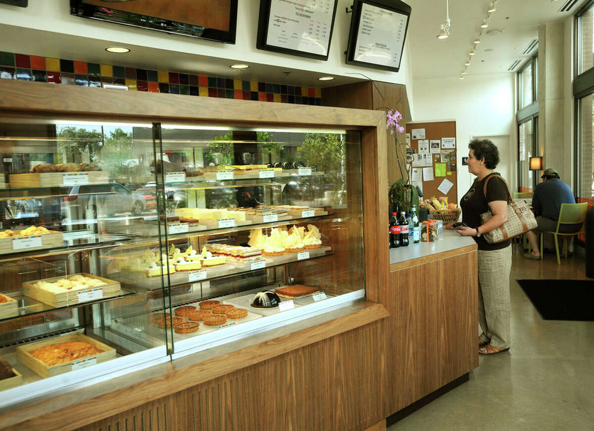 Baked goods are displayed in a case at the bakery. Breads, cookies, profiteroles and pan dulce are among items made and sold there.