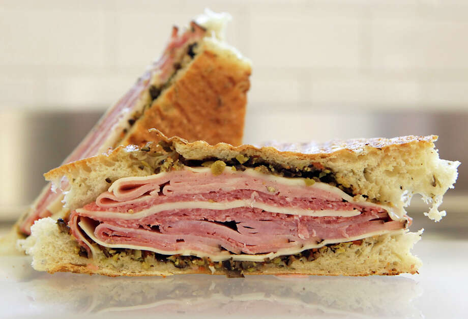 The muffaletta sandwich is served on foccacia made at the CIA Bakery Café at the Pearl. WILLIAM LUTHER / EXPRESS-NEWS / San Antonio Express-News