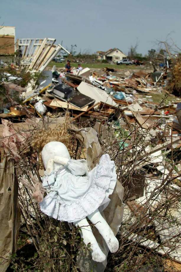 A doll hangs in a bush at a home in Colerain, N.C., Monday, April 18, 2011 after a tornado ripped through the area Saturday.  (AP Photo/Jim R. Bounds) Photo: Jim R. Bounds