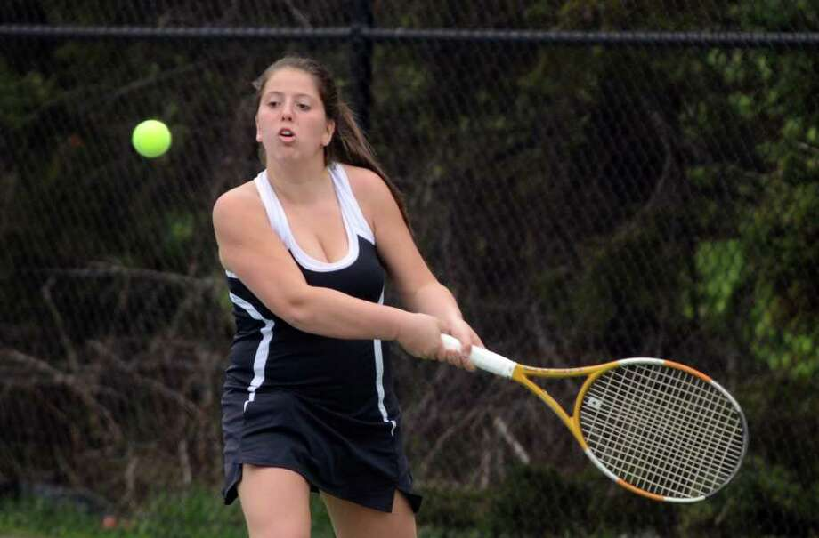 Fairfield Warde's Haley Wolf, no. 2 singles, returns the serve during the girls tennis match against Staples at Warde on Monday, Apr. 18, 2011. Photo: Amy Mortensen / Connecticut Post Freelance