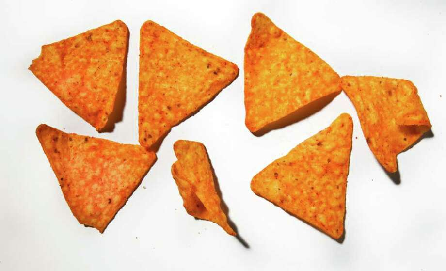 What does 100 calories look like? Doritos Nacho Cheese Chip flavored tortilla chips (7 chips): 95 calories. (Bill Hogan/ Chicago Tribune/MCT) Photo: Bill Hogan, MBR / Chicago Tribune
