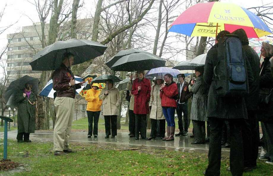 Iain Bruce, father of Cameron Bruce, who died in September after falling out of a window of his college university dormitory, addresses Cameron's family and friends at a memorial tree planting at Queen's University in Kingston, Ontario, Canada. Photo: Tori Stafford, Tori Stafford - Kingston Whig-Standard / Westport News