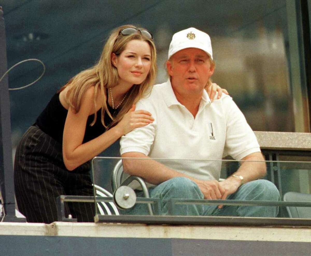 FLUSHING MEADOWS, UNITED STATES: Donald Trump and his girlfriend, Celina Midelfar, watch Conchita Martinez and Amanda Coetzer Sepi, 7, 1998, at US Open in Flushing Meadows, NY. AFP PHOTO Timothy CLARY