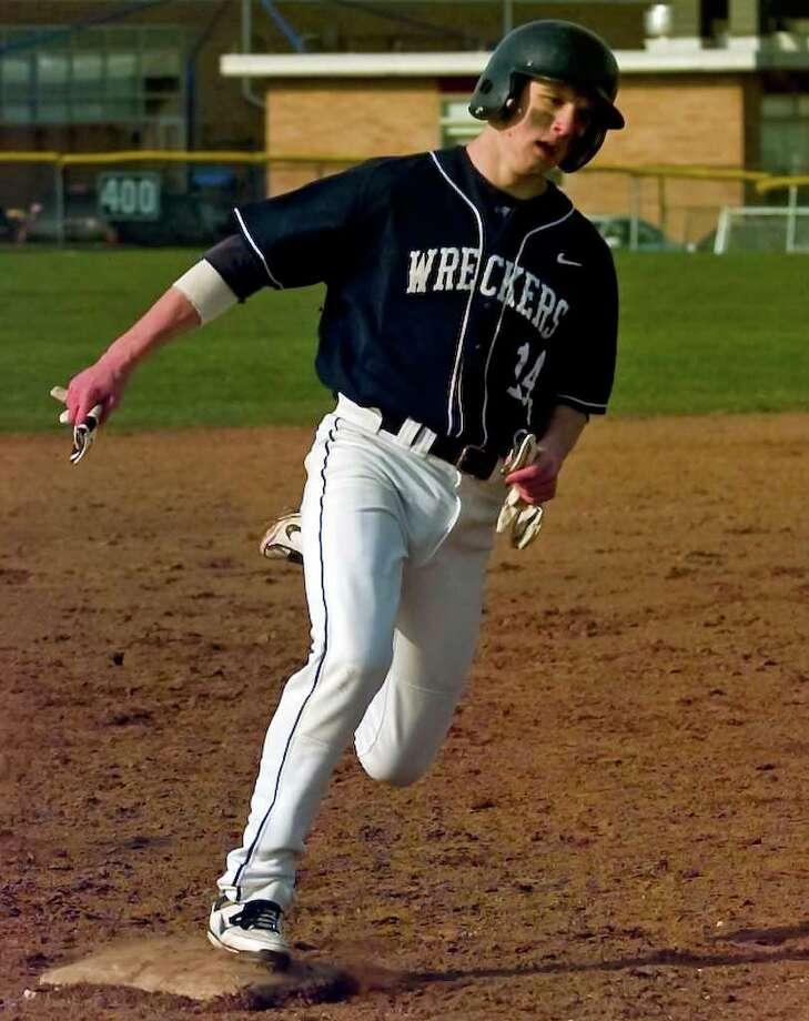Staples' #14 Mike Scott rounds third, during boys baseball action against Fairfield Warde in Fairfield, Conn. on Thursday April 14, 2011. Photo: Christian Abraham / Connecticut Post