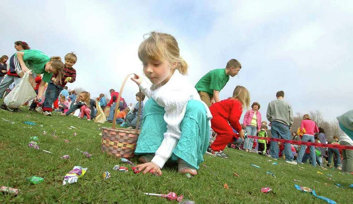 Katie Schultis, 5, center, collects candy as she and others participate in an Easter Egg Hunt at North Greenbush Recreation Center, Saturday, April 15,2006. (Times Union Archive)