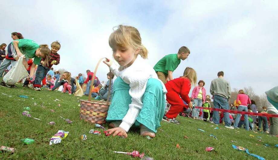 Katie Schultis, 5, center, collects candy as she and others participate in an Easter Egg Hunt at North Greenbush Recreation Center, Saturday, April 15,2006. (Times Union Archive) Photo: STEVE JACOBS / ALBANY TIMES UNION