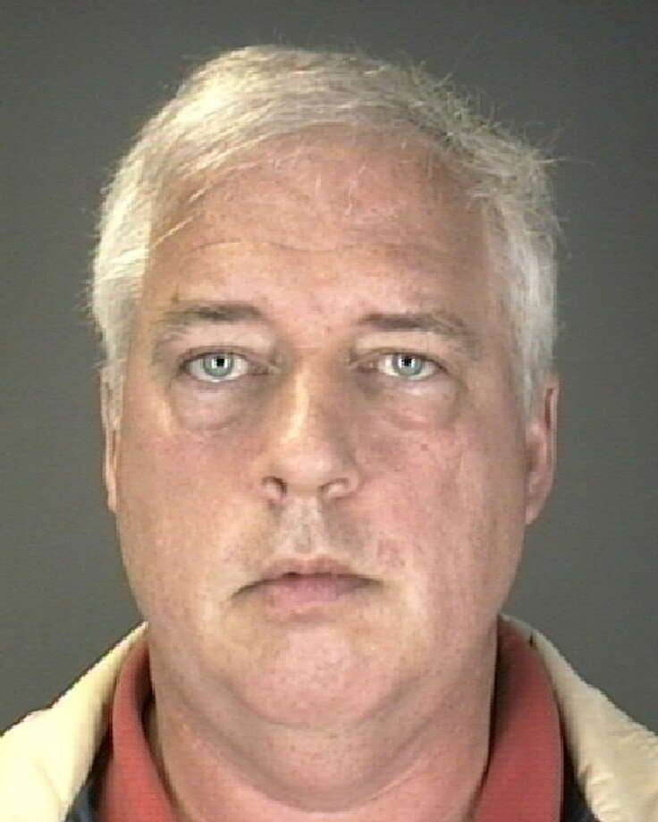 Douglas Lindsey, 52, of Colonie, NY, was arrested on April 12, 2011, after Colonie police said he and his wife, Sheryl Lindsey, 57, of Colonie, NY, left two infants in their car while they drank alcohol inside Tommy's tavern on Albany Shaker Road, in Colonie. (Colonie Police Department)