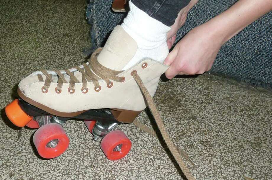 Caracas, Venezuela: Roller skate to mass As in many Catholic countries, people go to mass during the holidays in Caracas, Venezuela. The only difference is that here, they roller skate. The streets are closed off in the early mornings between December 16 and December 24, no cars or buses, just skaters on their way to church. Photo: Anne W. Semmes / Greenwich Citizen