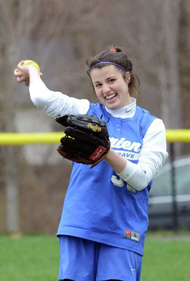 Darien's Emily Moscatello warms up in right field between innings during the softball game against Norwalk at Darien on Monday, Apr. 18, 2011. Photo: Amy Mortensen / Connecticut Post Freelance