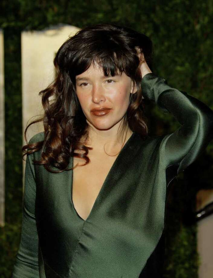 "FILE- In this, Feb. 27, 2011 file photo, Paz de la Huerta arrives at the Vanity Fair Oscar Party at the Sunset Tower in Los Angeles. Prosecutors say TV actress Paz de la Huerta derided a former reality TV figure as a ""fake actress"" after attacking her in a posh New York City hotel bar. The ""Boardwalk Empire"" actress was arraigned Tuesday, April 19, 2011 on assault and other charges in her March 20 encounter with Samantha Swetra. (AP Photo/Carlo Allegri, File) Photo: Carlo Allegri"