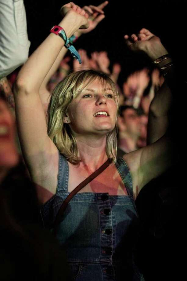 Actress Kirsten Dunst dances in the audience during Day 2 of the Coachella Valley Music & Arts Festival 2011 held at the Empire Polo Club in Indio, California.  Photo: Christopher Polk, Getty Images / 2011 Getty Images