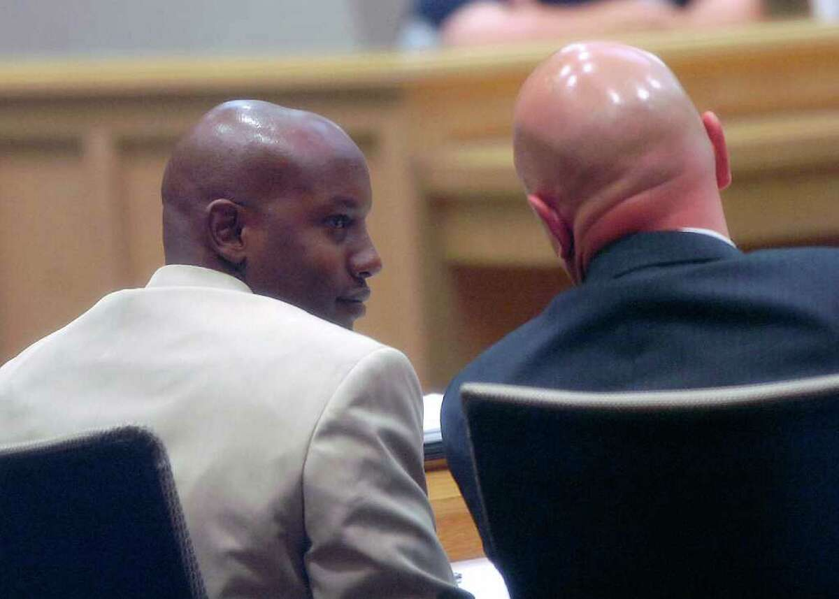 Former Orange police captain Robert Arnold, left, went to arbitration Tuesday morning. His attorney, Greg Cagle, is on the right. Arnold killed James Whitehead on July 26 in the parking lot of an O'Reilly Auto Parts store on 16th Street in Orange. The shooting occurred while Arnold was off-duty. Dave Ryan/The Enterprise