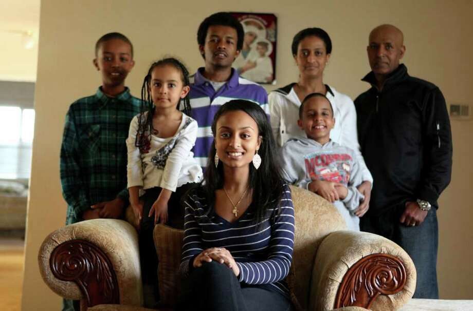"Meseret ""Missy"" Alemu, center, is shown with her family, from left, Abel Berhan, 11, Sarah Berhan, 4,  Fasil Berhan, 17, mother Hareg Egezew, Yonathan Berhan, 9, and her father Yeshiwas Egezew. She is the first in her family to go to college and will start after high school graduation. Photographed on Wednesday, April 6, 2011 . Photo: JOSHUA TRUJILLO / SEATTLEPI.COM"