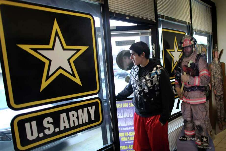 Skyline High School senior Josue Lopez walks into a U.S. military recruiting office on March 30, 2011 in Bellevue. Lopez, who plans to join the U.S. Marine Reserves after high school hopes to attend college via the program. Photo: Joshua Trujillo, JOSHUA TRUJILLO / SEATTLEPI.COM