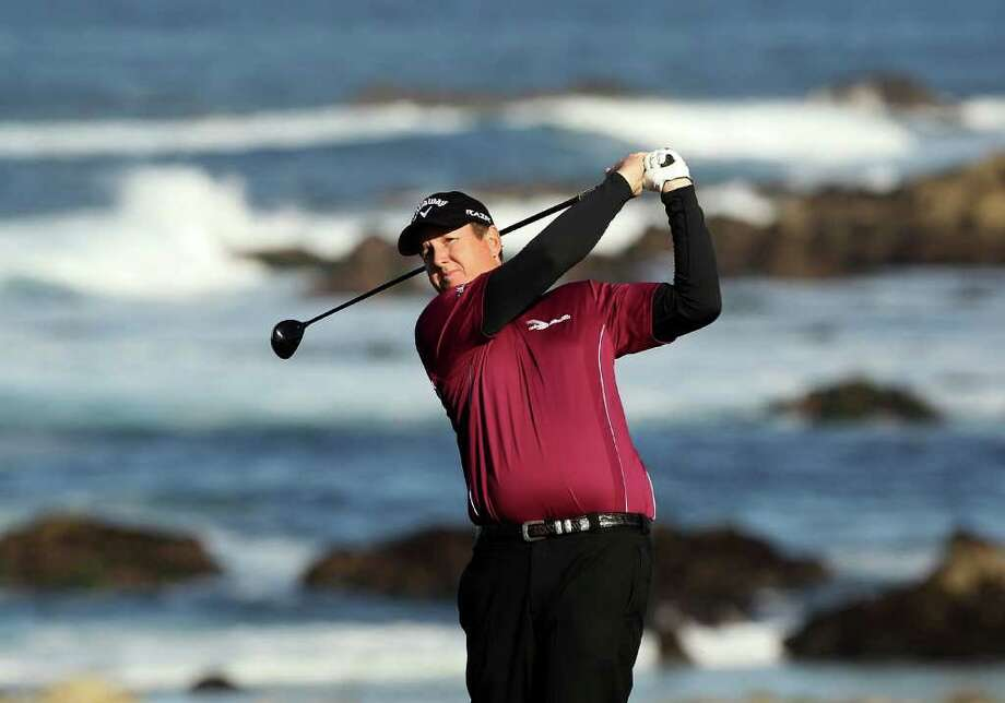 PEBBLE BEACH, CA - FEBRUARY 11:  J.J. Henry tees off on the 13th hole during the second round of the AT&T Pebble Beach National Pro-Am at Monterey Peninsula Country Club on February 11, 2011 in Pebble Beach, California.  (Photo by Ezra Shaw/Getty Images) *** Local Caption *** J.J. Henry Photo: Ezra Shaw, Getty Images / 2011 Getty Images