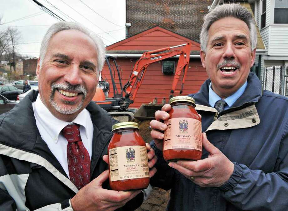 Co-owners of Minissale's Restaurant, Ted Minissale, left, and Phil Minissale with their new tomato sauces during ground breaking ceremonies in Troy Tuesday morning April 19, 2011.  (John Carl D'Annibale / Times Union) Photo: John Carl D'Annibale / 00012847A