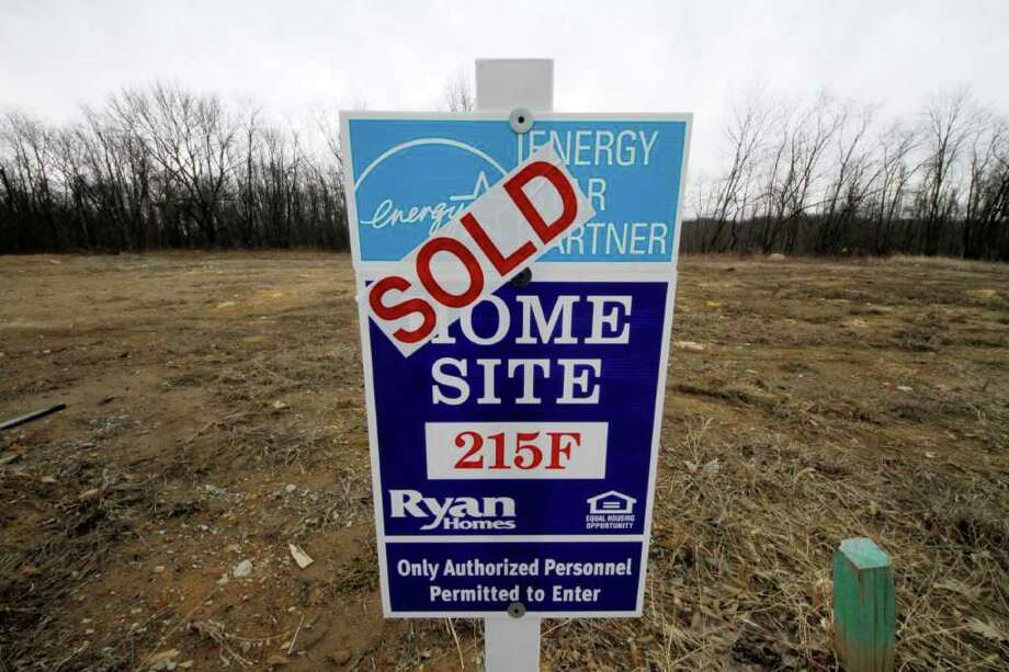 In this Feb. 20, 2011 photo, a sold home site is shown in Canonsburg, Pa. Builders broke ground last month on the most new homes in six months, giving the weak housing market a slight boost at the start of the spring buying season. (AP Photo/Gene J. Puskar) Photo: Gene J. Puskar