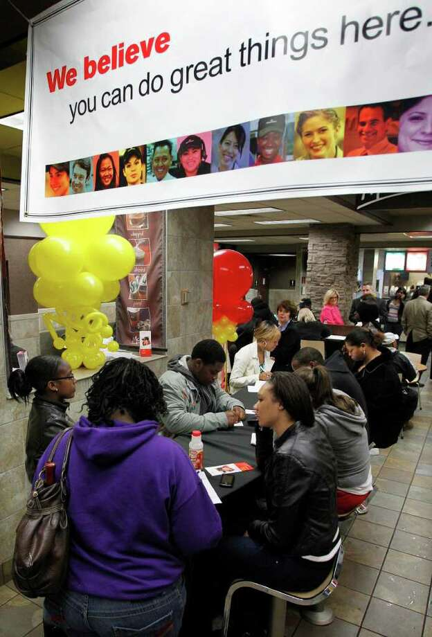 As part of McDonald's National Hiring Day job seekers fill out applications before being interviewed during the lunch hour at a downtown Pittsburgh McDonald's restaurant Tuesday, April 19, 2011. Pittsburgh area McDonald's are looking to hire 1,500 new crew and restaurant management positions. (AP Photo/Gene J. Puskar) Photo: Gene J. Puskar