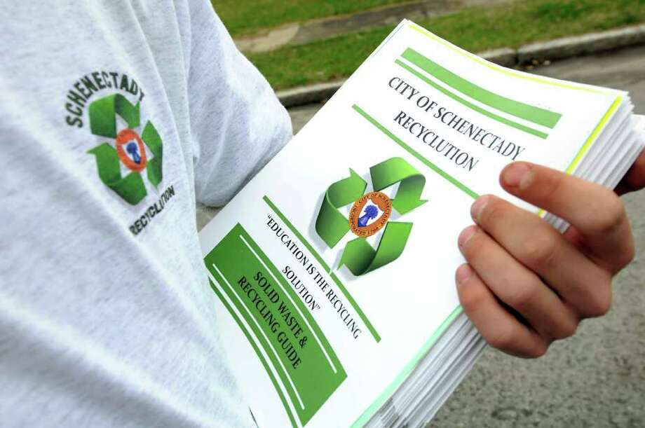 Waste department worker Anthony Verrigni prepares to hand out brochures about recycling in the Bellevue neighborhood on Tuesday, April 19, 2011, in Schenectady, N.Y. (Cindy Schultz / Times Union) Photo: Cindy Schultz