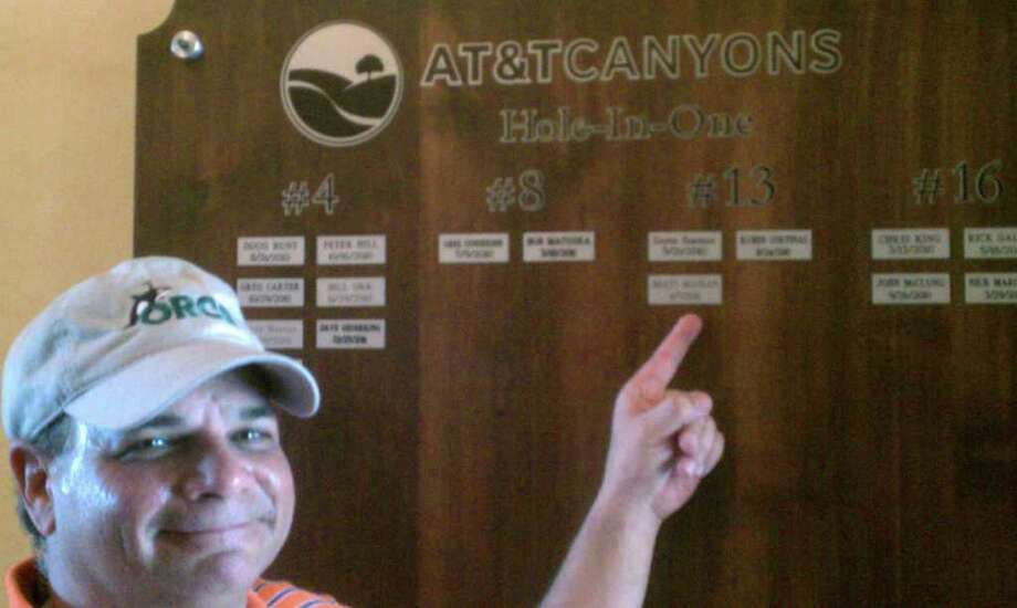 Brett Bostian points to a plaque listing his April 7 No. 13 hole-in-one at TPC San Antonio's Canyons course (185 yards, 4-iron). It was Bostian's first career ace. Photo: Courtesy Photo