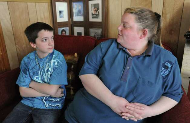Sixth grader Adam Johns talks to his mother April Johns after school in their home in Schenectady, N.Y. on Friday April 15, 2011. Adam was sent to a kindergarten class as a form of discipline at school. (Lori Van Buren / Times Union) Photo: Lori Van Buren