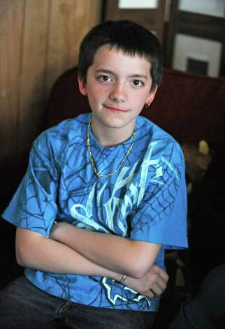 Sixth grader Adam Johns sits on the couch in his home in Schenectady, N.Y. after school on Friday April 15, 2011. Adam was sent to a kindergarten class as a form of discipline at school. (Lori Van Buren / Times Union) Photo: Lori Van Buren