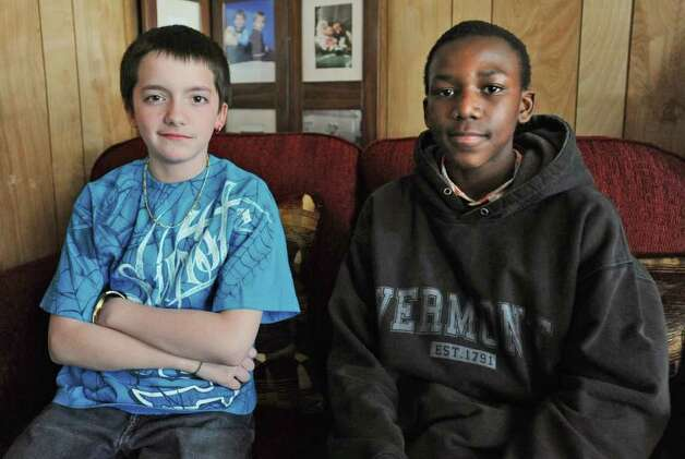 "Hamilton Elementary sixth graders Adam Johns and Clifton ""CJ"" Manning Jr.  sit on a couch in Adam's home in Schenectady, N.Y.on Friday April 15, 2011. Adam and CJ were sent to a kindergarten class as a form of discipline at school. (Lori Van Buren / Times Union) Photo: Lori Van Buren"