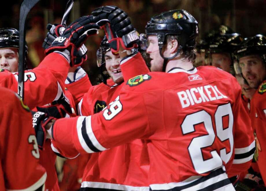 Chicago Blackhawks center Michael Frolik, center, celebrates his second-period goal with his teammates in Game 4 of an NHL hockey Stanley Cup playoffs first-round series against the Vancouver Canucks, Tuesday, April 19, 2011, in Chicago. (AP Photo/Nam Y. Huh) Photo: Nam Y. Huh