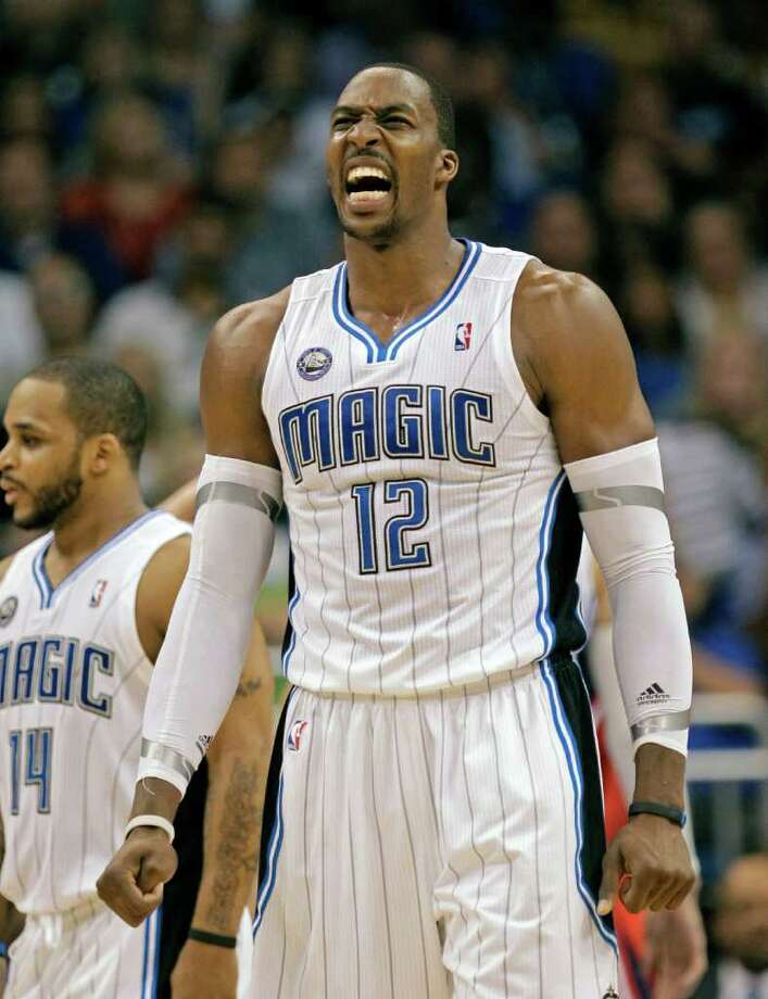 Orlando Magic's Dwight Howard (12) reacts before a free throw after he was fouled during the first half of Game 2 of a first-round NBA playoff basketball series against the Atlanta Hawks in Orlando, Fla., Tuesday, April 19, 2011.(AP Photo/John Raoux) Photo: John Raoux