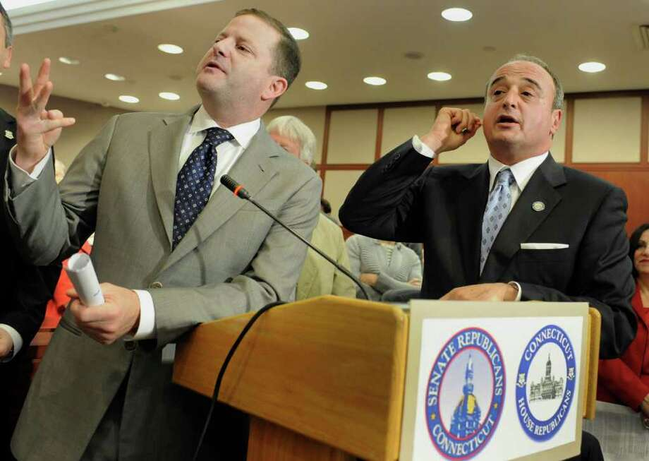 Connecticut Senate Minority Leader John McKinney, R-Fairfield, left, and House Minority Leader Lawrence Cafero, R-Norwalk,  speak during a news conference to unveil the Republican's alternative budget at the Legislative Office Building in Hartford, Conn., Tuesday, April 19, 2011.  The Republican state budget proposal doesn't raise taxes and calls for cutting the state employee workforce by five percent. (AP Photo/Jessica Hill) Photo: Jessica Hill, AP Photo/Jessica Hill / AP2011
