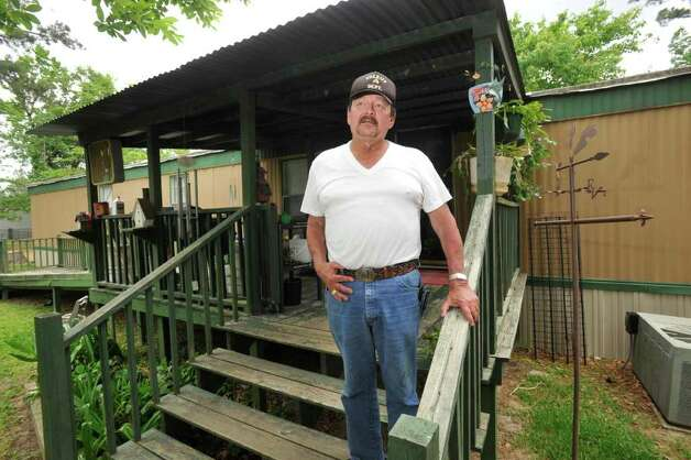 "Jon Nicholas pictured on the back porch of his Lumberton mobile home. Nicholas who lives in a mobile home in Lumberton, has been told by State Farm his home insurance policy won't be renewed. That's because State Farm no longer wants to cover older mobile homes, but still will offer coverage for newer ""manufactured housing."" The termination of Mr. Nicholas' policy also means he's losing the discount he received for auto insurance because he had his policies ""bundled, "" meaning the insurer provided multiple products.   Tuesday, April 19, 2011.  Valentino Mauricio/The Enterprise Photo: Valentino Mauricio / Beaumont"