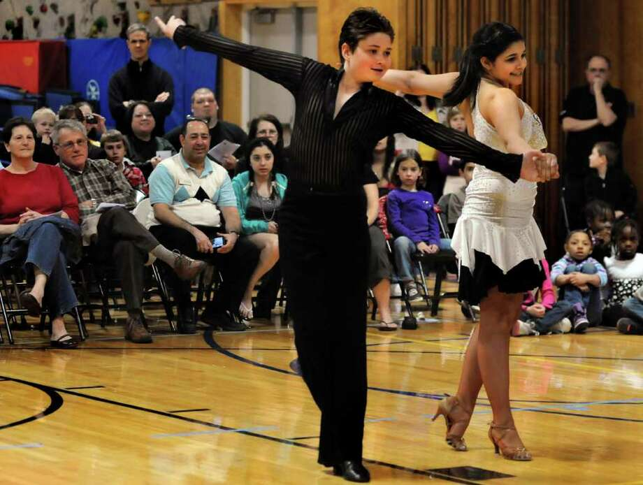 """Greg Hayner, 13, center, and Rachel Quinn, 13, dance the Cha Cha to Michael Jackson's """"Black or White"""" during the 6th Annual Zoller Ballroom Kids Grand Finale on Thursday, April 14, 2011, at Zoller Elementary School in Schenectady, N.Y. (Cindy Schultz / Times Union) Photo: Cindy Schultz"""