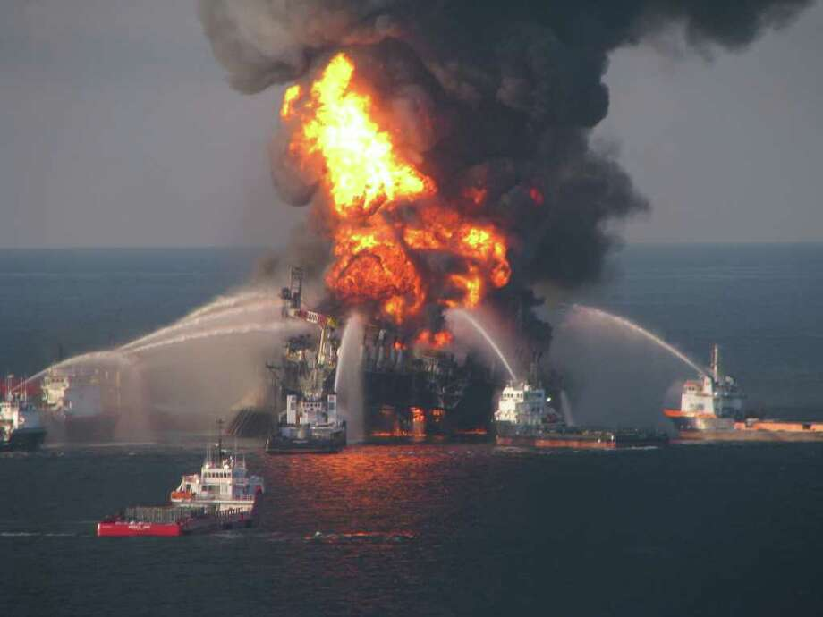 In this April 21, 2010 file photo provided by the U.S. Coast Guard, fire boat response crews spray water on the blazing remnants of BP's Deepwater Horizon offshore oil rig. An April 20, 2010 explosion at the offshore platform killed 11 men, and the subsequent leak released an estimated 172 million gallons of petroleum into the gulf. Photo: AP