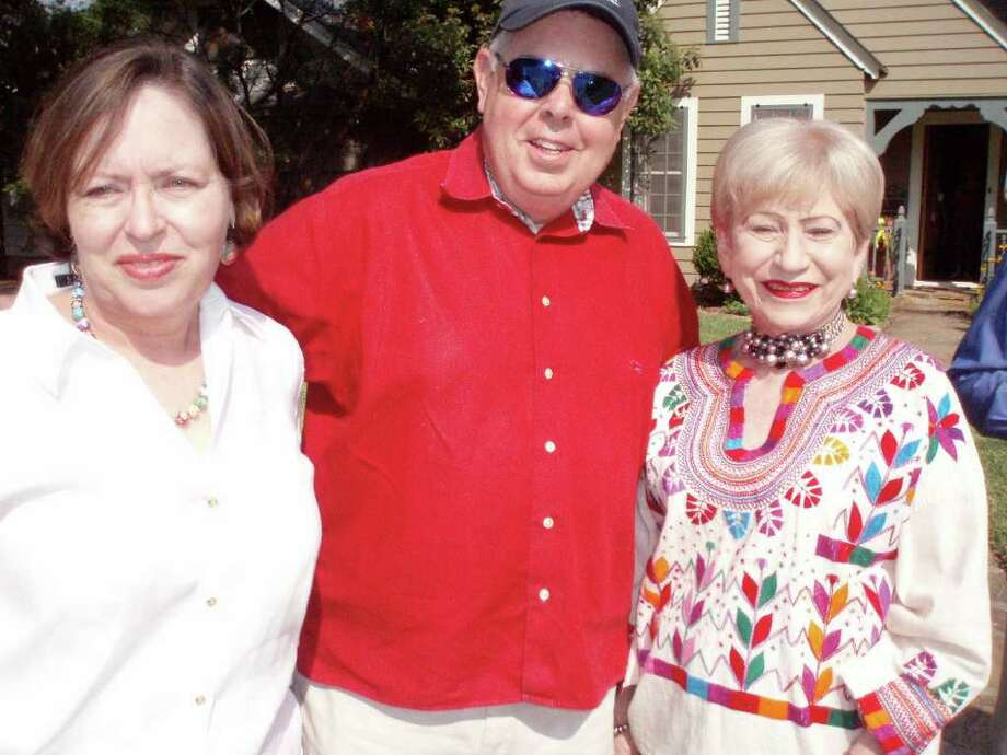 Jamie and John Bloodsworth enjoy the Pooch Parade at their home with family and friends, including Barbara McGaughy.