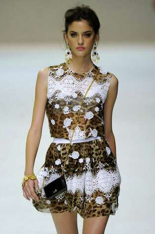 Bright white lace is worked into leopard print by Dolce & Gabbana.