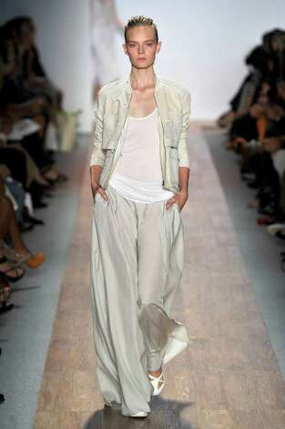 Max Azria anchors a flowing pantsuit with a sheer bright white tank for a spring summer look.